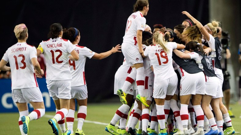 Canadian players celebrate Ashley Lawrence's goal against Netherlands at the FIFA Women's World Cup on January 15, 2015.